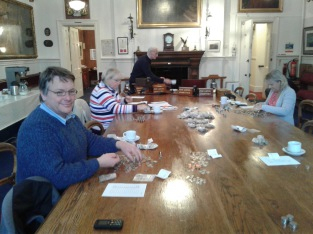 Members of the choir committee counting the christmas eve collection