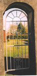 Metal arch top gate with scroll pattern by Kevin Gerry