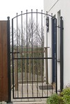 Curved top iron gate by Kevin Gerry