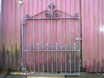 Wrought iron single gate with hand forged scrolls by Kevin Gerry