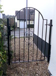 Single gate with curved top and scroll pattern by Kevin Gerry