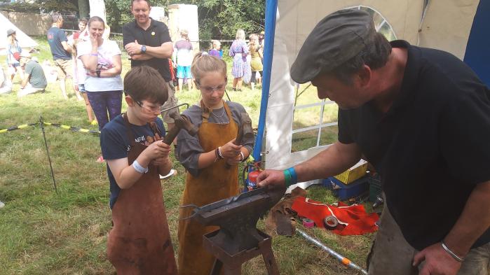 Dan and Richard doing a forging demonstrating at Stithians Show 2016.