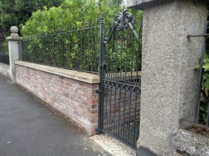 Picture of railings with large rosette pattern.