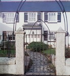 Gate with arch top and arch overthrough by Kevin Gerry